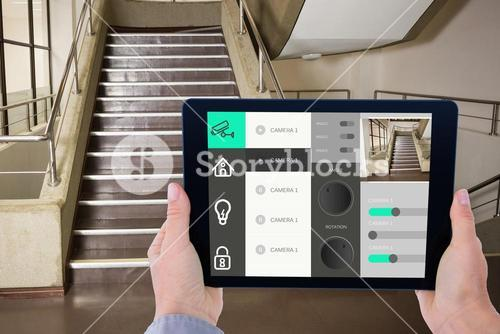 Man using tablet for home automation