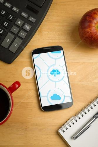 Smartphone with cloud computing apps on desk