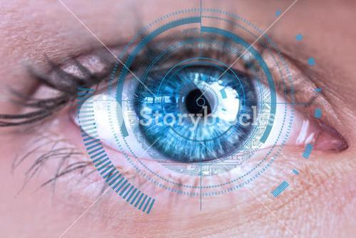 Eye scanning a futuristic interface