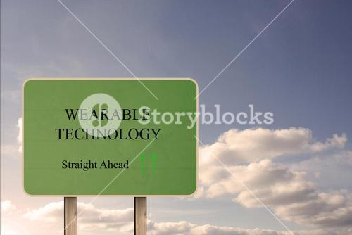 Green street sign showing wearable technology