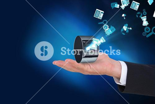 Businessman holding smart watch with icons