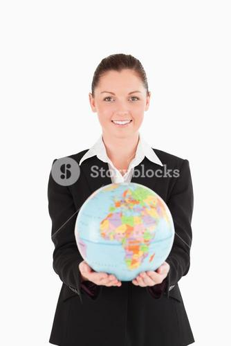 Beautiful woman in suit holding a globe