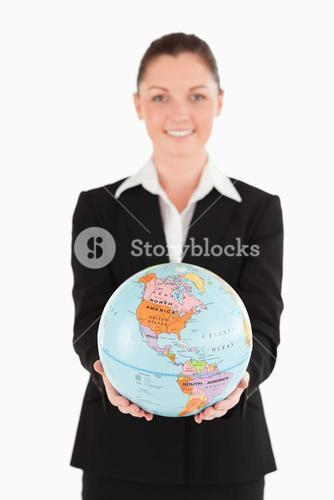 Good looking female in suit holding a globe
