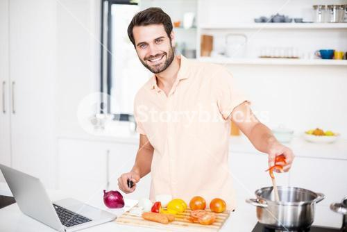 A Man is cooking food