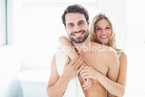 Happy young couple cuddling