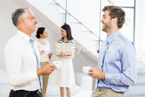Businessmen interacting during a break time