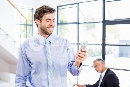 Businessman texting a message on phone
