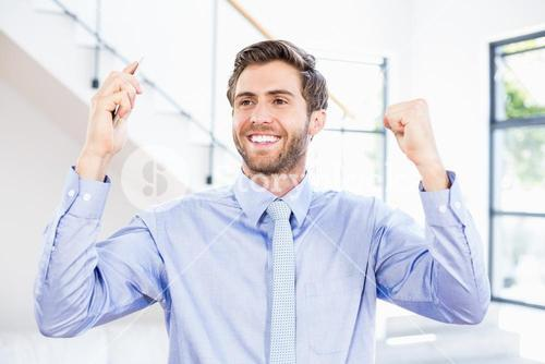 Excited businessman in office