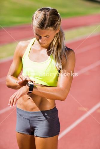 Female athlete checking her smart watch