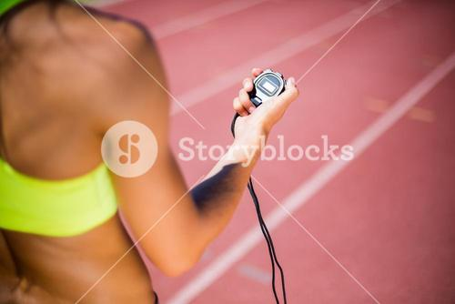 Mid-section of female athlete checking her smart watch