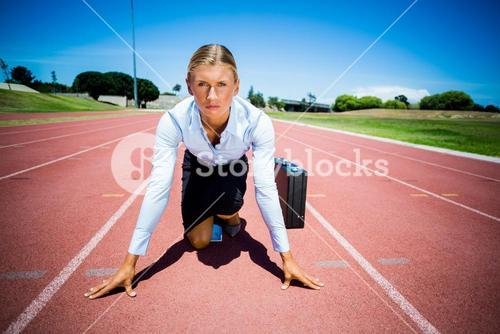 Portrait of businesswoman with briefcase ready to run
