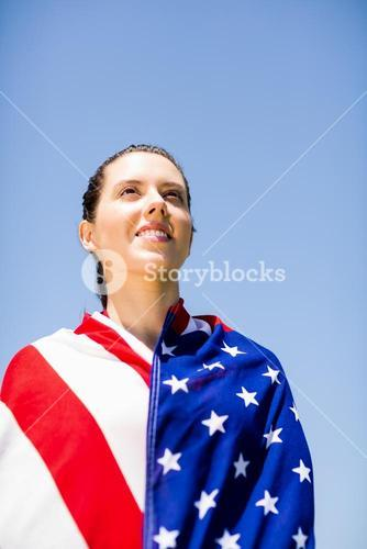 Female athlete wrapped in american flag