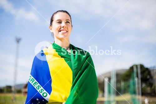Female athlete wrapped in Brazilian flag
