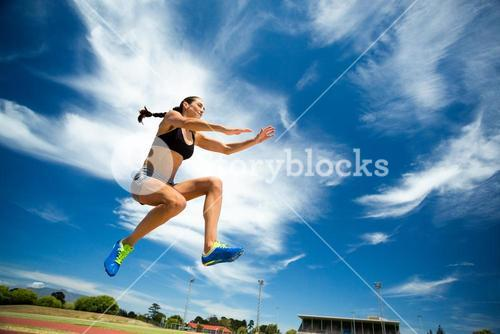 Female athlete performing a long jump