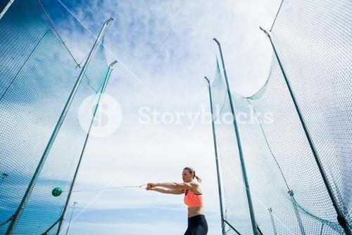 Female athlete performing a hammer throw