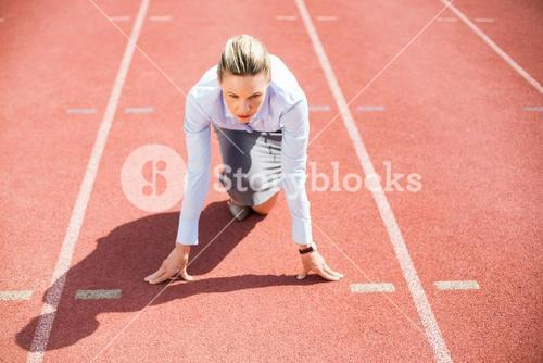 Businesswoman in ready to run position