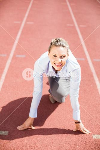 Portrait of businesswoman in ready to run position