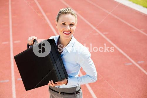 Portrait of happy businesswoman with briefcase