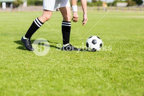 Football player picking up the ball
