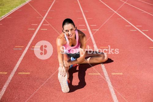 Portrait of female athlete stretching her hamstring