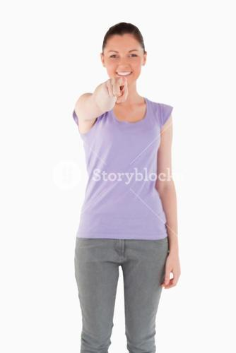 Good looking woman pointing at the camera while standing