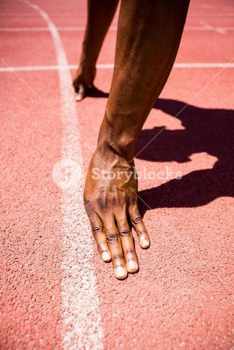 Hands of athlete on a starting line