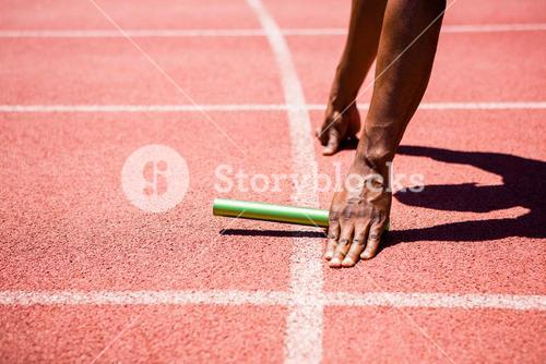 Hands of athlete holding baton