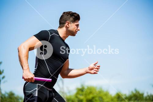 Relay athlete running with baton
