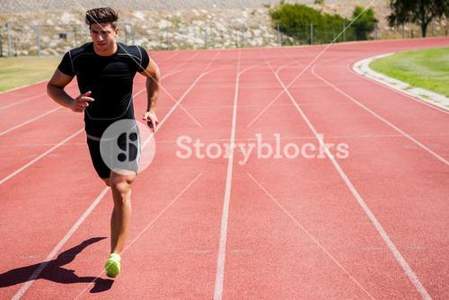 Athlete running on the racing track