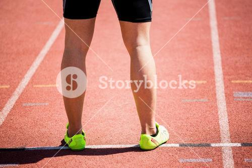 Feet of an athlete on running track