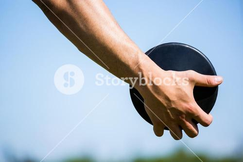 Close-up of hand holding a discus