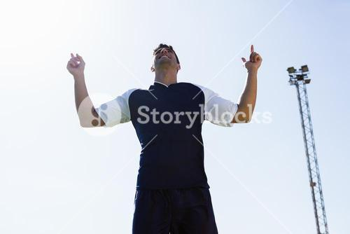 Soccer player posing after victory