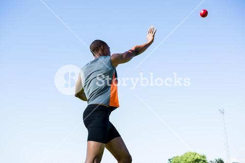Athlete throwing shot put ball