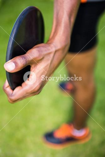 Close-up of athlete holding a discus