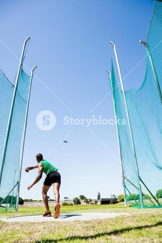 Athlete throwing discus in stadium