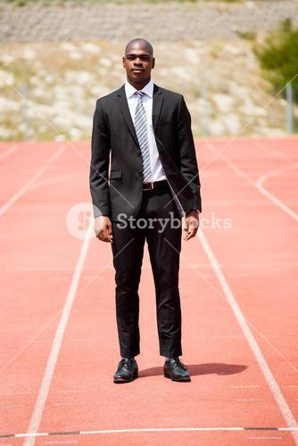 Businessman standing on a racing track