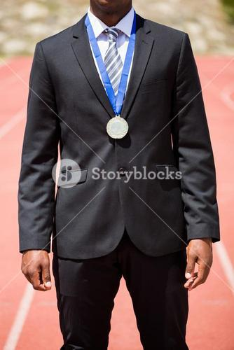 Businessman wearing gold medal