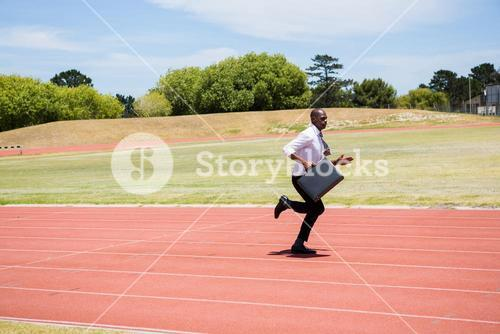 Businessman running on a running track
