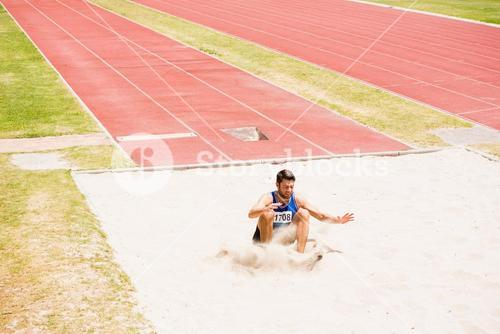 Athlete landing on sandpit