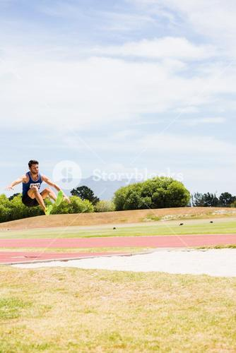 Athlete performing a long jump