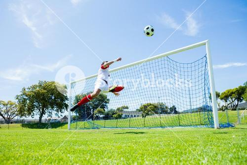 Football player scoring a goal