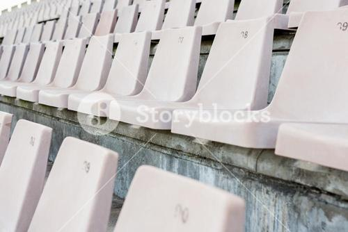 Empty row of white seats