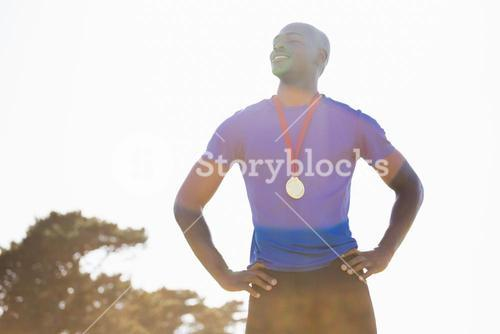 Athlete with gold medal around his neck