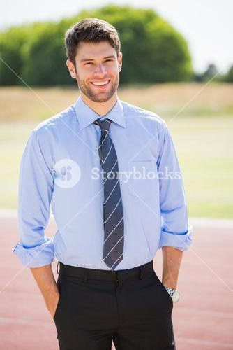 Portrait of businessman standing with hands in pocket