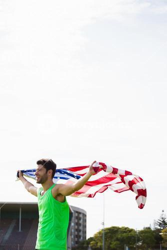 Athlete posing with american flag