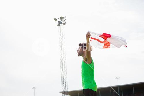 Athlete posing with england flag after victory