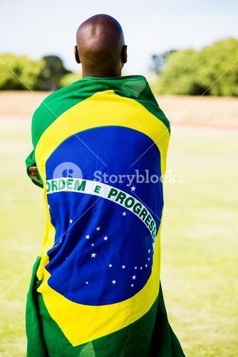 Athlete with brazilian flag wrapped around his body