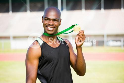 Athlete showing his gold medal