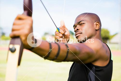 Athlete practicing archery