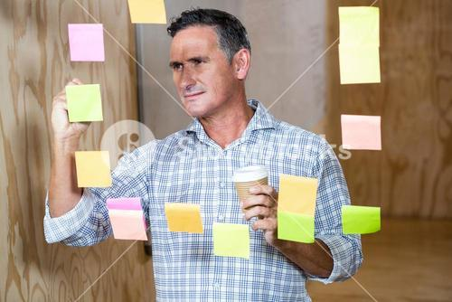 Man writing on sticky notes